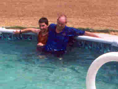 My Grandpa and I playing in the pool.